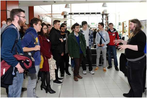 Participants listening to Dr. Graeme Burt during the tour.