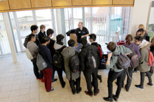 Dr. Lee Jones (STFC ASTeC) shows students how an electric field can be used to accelerate a charged particle